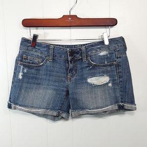 folded raw hem factory destressed shorts